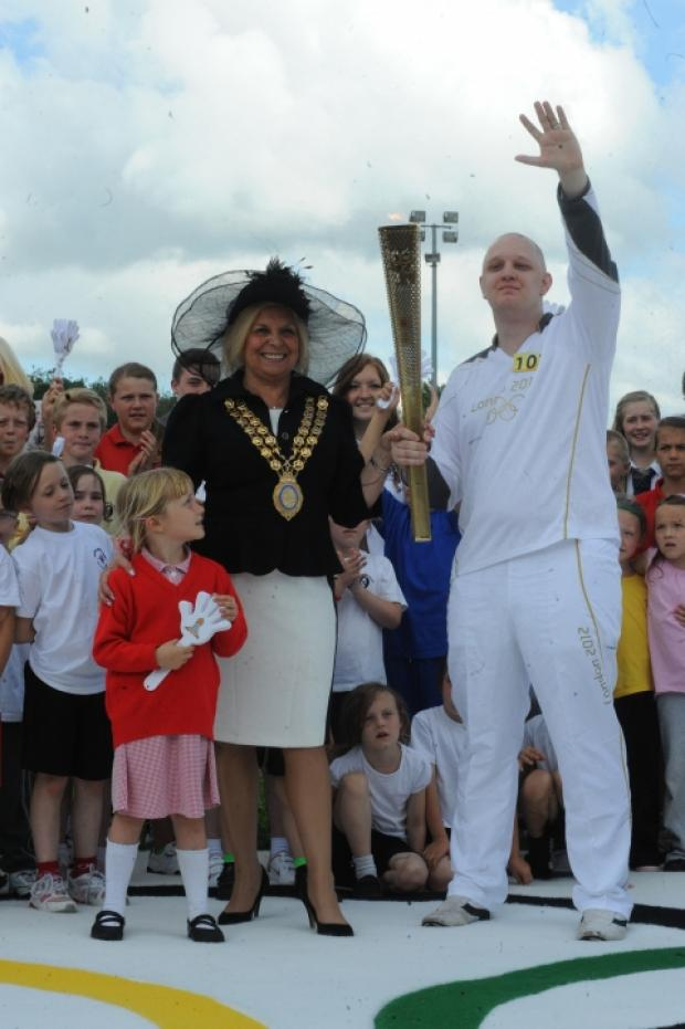 Torch relay comes to town. Marc Grayston, with torch and mayor Mo Larkin