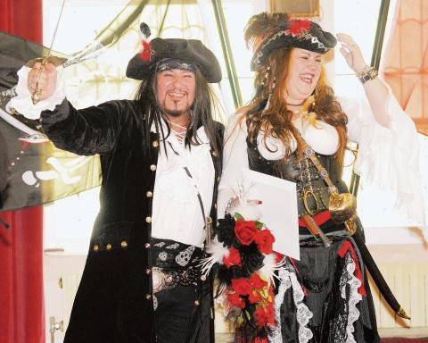 Shiver me timbers! James and Emma on their big day