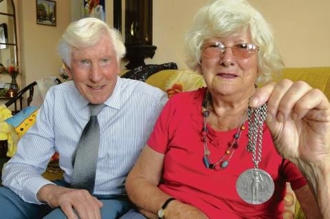 June Guild – with husband John and her commemorative medal