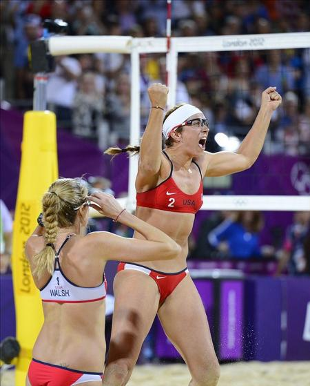 USA's Misty May-Treanor (right) and Kerri Walsh (left) celebrate winning gold in the women's beach volleyball at Horse Guards Parade. Pic: Chris Hanewinckel-USA TODAY Sports