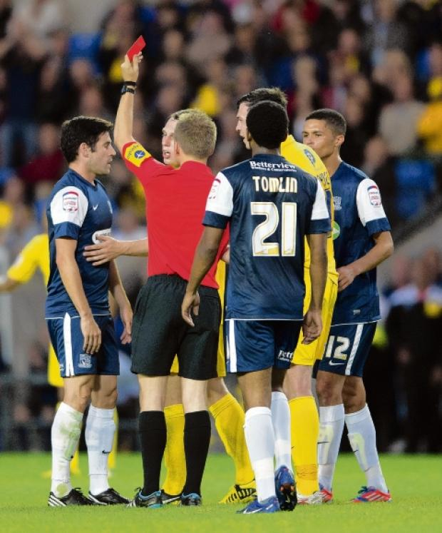 Seeing red - Michael Timlin is dismissed against Oxford United