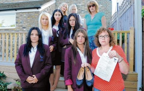 Pupils and mums, including mum Sarah Hince, far right, holding her daughter's shoes