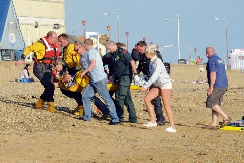 T-Jay is rushed off the beach after being rescued