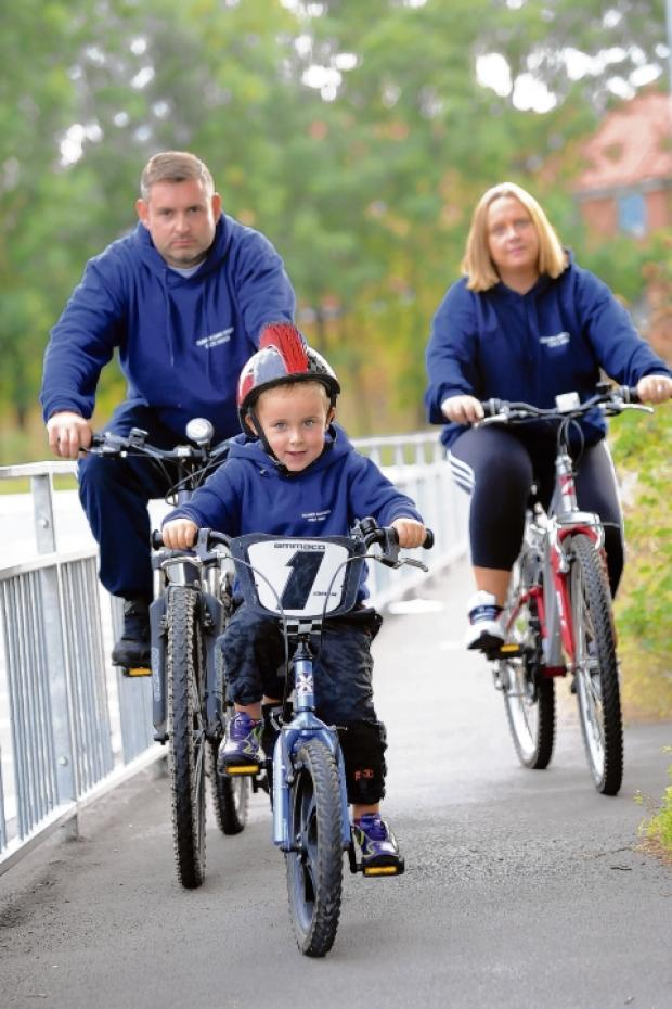 Safety first – Paul, Laurie and Mandy Shelford on their cycles