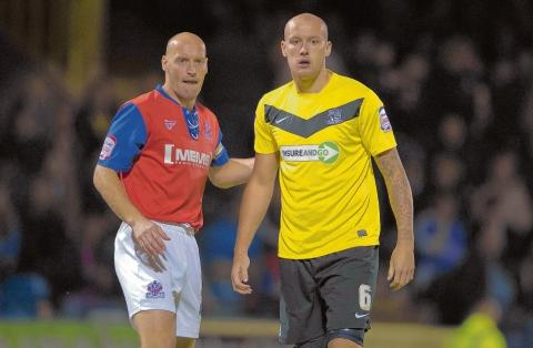 Adam Barrett (left) will be returning to Roots Hall this aftern