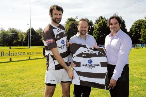 Shirt deal — (from left) club player and solicitor Andrew McClintock, Sam Robinson, a partner at Paul Robinson Solicitors, and Southend RFC marketing drector Nathan Strange with one of the sponsored shirts