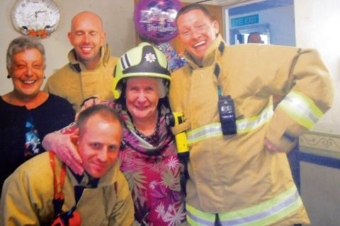 Unexpected guests – Irene Pennick entertains her firemen, after they were called out on an automatic alarm