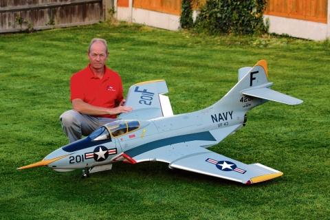 Upset  Martin Mead with one of his model aircraft