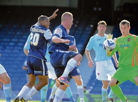 Freddy Eastwood heads home the winning goal against Exeter City