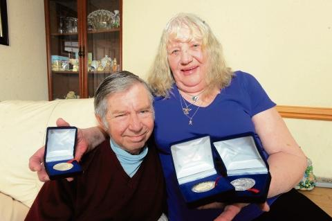 Michael and Valerie Knights with his Diabetes  Society medals