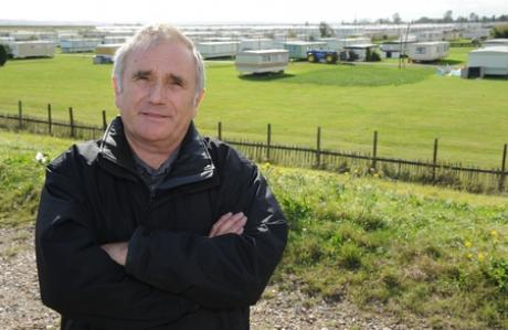 Councillor Dave Blackwell overlooking Thorney Bay Caravan site which has been earmarked for development.