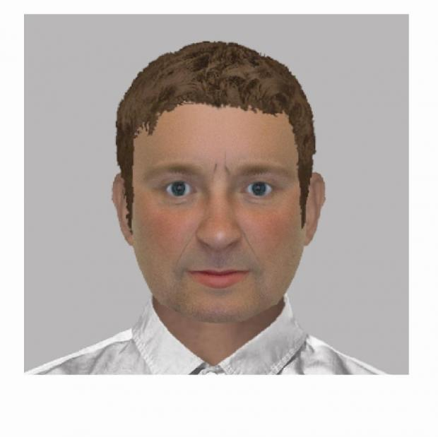 E-fit of burglar who woke elderly woman