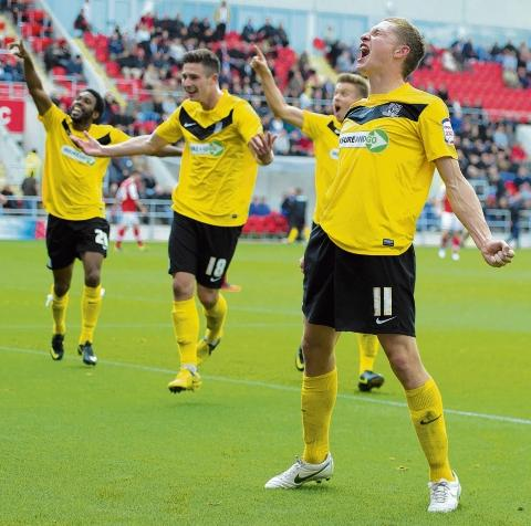 David Martin celebrates scoring at Rotherham