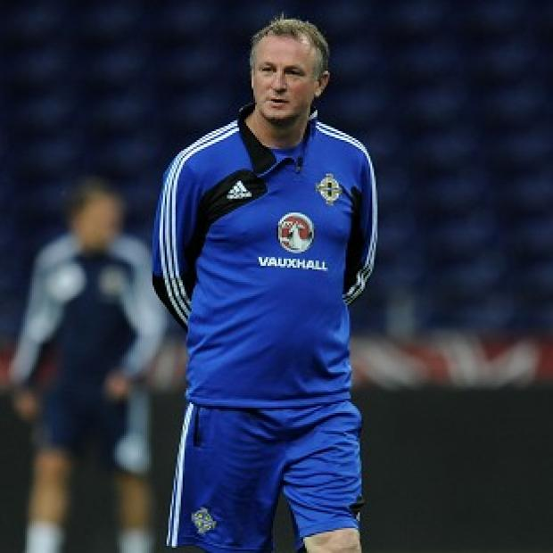 Michael O'Neill's Northern Ireland side held Portugal to a 1-1 draw in Lisbon