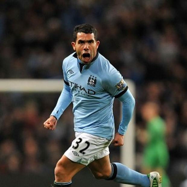 Carlos Tevez proved the difference as Manchester City beat Swansea