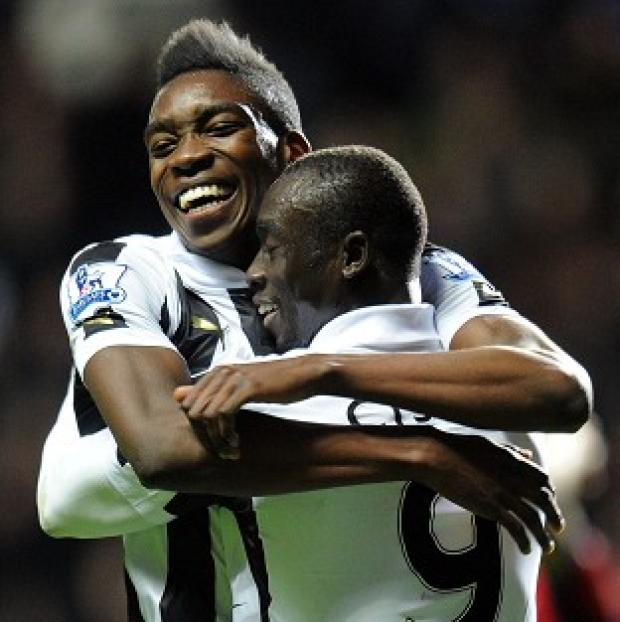Newcastle's Papiss Cisse, right, celebrates scoring the winner