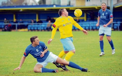 Pushing for a start – Billericay captain Rob Swaine, challenging former Canvey Island and now Concord man, Jason Hallett.