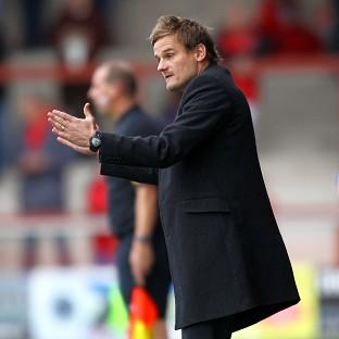 AFC Wimbledon manager Neal Ardley will lead his team against MK Dons