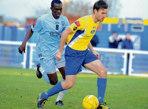 Heat of the battle – Billericay midfielders Junior Luke and Nicky Cowley square up in their derby.