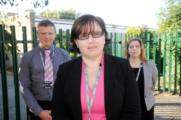Elizabeth Baines, with staff, outside the Priory School