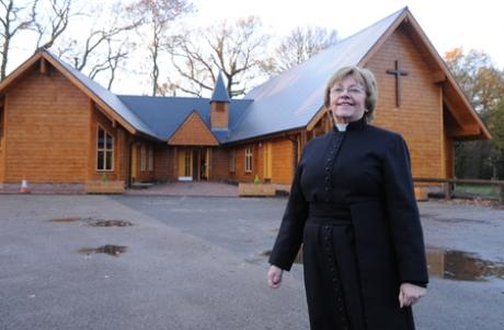 Proud day - Rev Marian Sturrock outside the new church