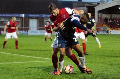 Britt Assombalonga battles for the ball with Fleetwood's Rob Atkinson