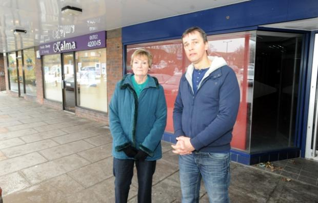 Mark Flewitt and resident Pam Farley outside the shop
