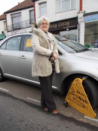 Susan Hatton with her clamped car