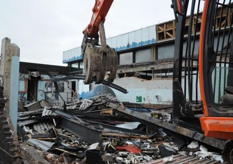 Bulldozers start to demolish pool
