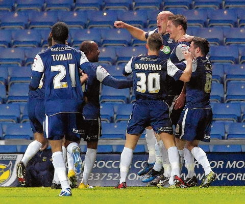 Barry Corr celebrates scoring at the Kassam Stadium