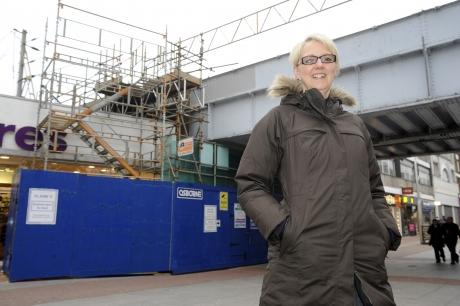 Echo: Dawn Jeakings, chairman of the town centre partnership, with the rail bridge