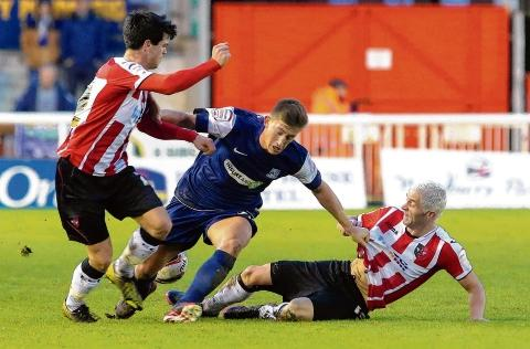Alex Woodyard is tackled by Exeter's John O'Flynn