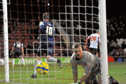 Barry Corr celebrates after heading Blues back level at Griffin Park