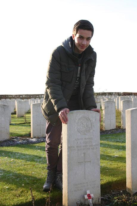 Teenager visits ancestor's grave on WW1 battlefield