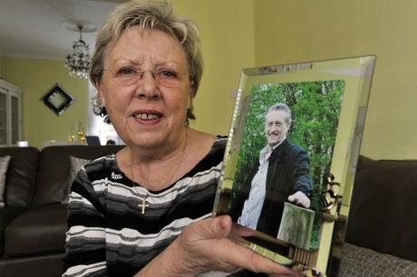 Carol Braithwaite with a photo of her late husband, Keith