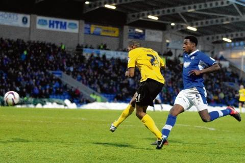 Gavin Tomlin fires home the only goal of the game at the Proact Stadium