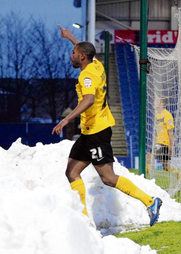 Gavin Tomlin celebrates scoring at Chesterfield on Saturday