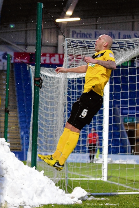 Air we go! Ryan Cresswell jumps for joy after Gavin Tomlin nets Southend's winning goal at Chesterfield on Saturday