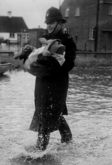 Then - PC Pilgrim carries Judy through the flood water