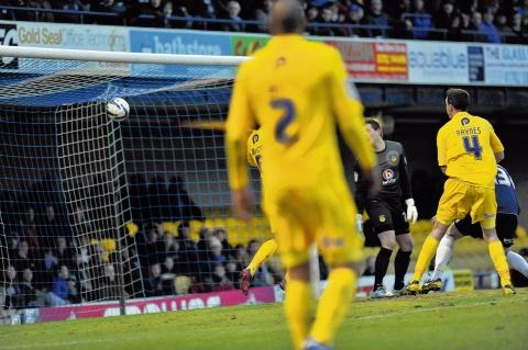 Beaten - Oxford goalkeeper Luke McCormick watches as Ryan Leonard's header flies into the back of the net