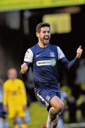 Michael Timlin celebrates after setting up Ryan Leonard's goal