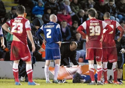 Heartbreak – for Blues midfielder Michael Timlin at Brisbane Road