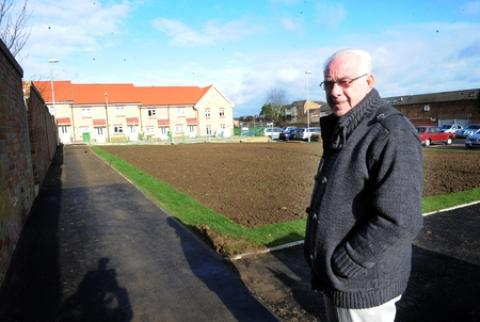 Edward Gallagher has criticised Swan Housing for taking two years to build a playground and play area on the Five Links estate.