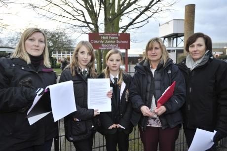 Pupils and parents: Debbie McSweeney, Ellie Scott, Chloe and Amanda Gillingan, Jacqui Smith outside the school gate with a petition.