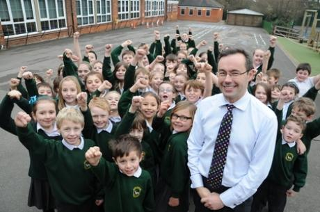 Delighted - South Benfleet primary school pupils celebrating alongside head teacher Dominic Carver