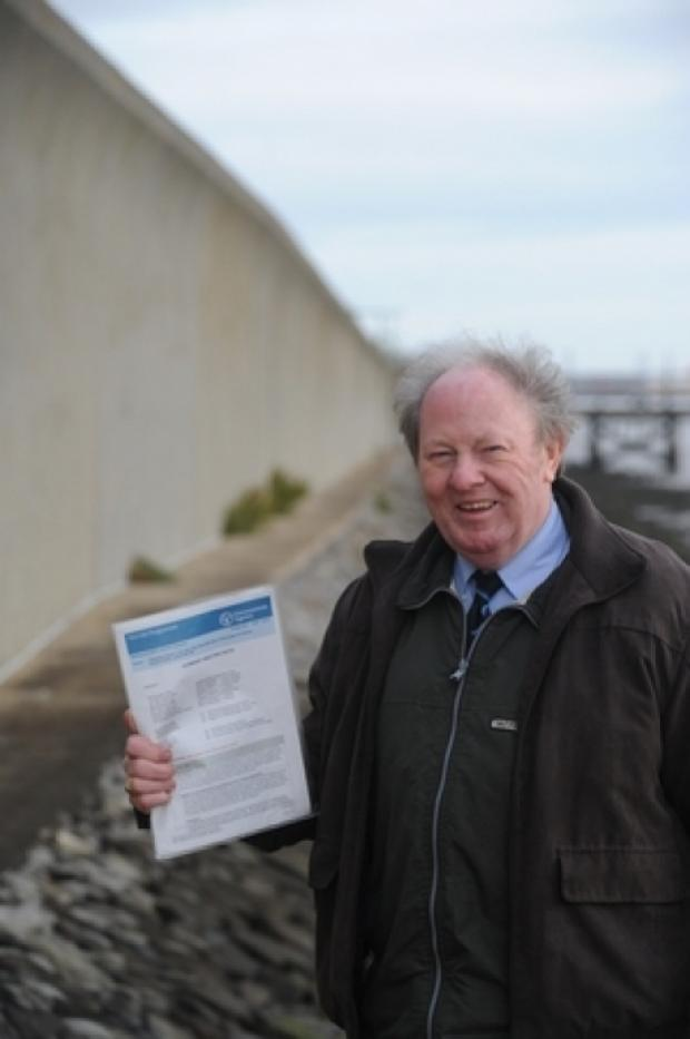 Protected - County councillor Ray Howard near the sea defences in Canvey