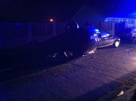 The black Ford Fiesta ended up on its roof in Moreland Avenue