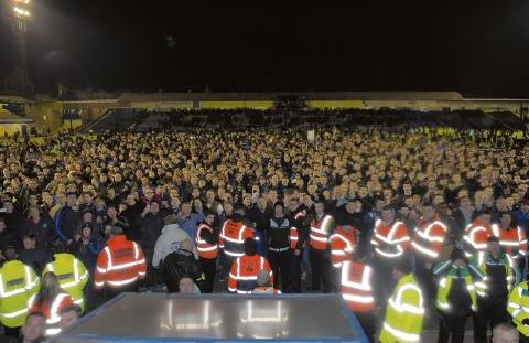 Southend United's fans celebrate on the pitch at the end of Wednesday's night match against Leyton Orient