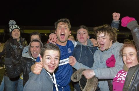 Mark Phillips celebrates with Southend United supporters after beating Leyton Orient