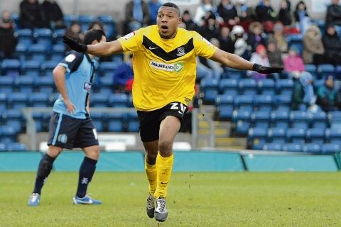 Britt Assombalonga celebrates his goal against Wycombe Wanderers